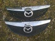 Продам оригинальную решетку радиатора Mazda 6 (2002-2008)